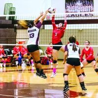 La Joya's Stefani Alaniz spikes the ball as Mission's Makayla Castillo goes for the block during the third set of the Lady Eagles' 3-0 win over the Lady Coyotes Tuesday night. Progress Times photo by Luciano Guerra.