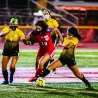 Sharyland's Xochitl Nguma fights off two Brownsville Hanna defenders for control of the ball during the second half of the Lady Rattlers' 8-1 non-district game win over the Lady Golden Eagles. Progress Times photo by Luciano Guerra