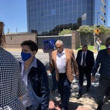 """Former La Joya Mayor Jose A. """"Fito"""" Salinas (center wearing the tan jacket) left the federal courthouse in McAllen on July 19, 2021, after pleading guilty to wire fraud. (Photo by Dave Hendricks / The Progress Times.)"""