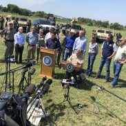 """Arizona Gov. Doug Ducey, at the podium, and other Republican governors joined Texas Gov. Greg Abbott on Wednesday to discuss what they called a """"crisis"""" at the border. (Dave Hendricks / The Progress Times)"""