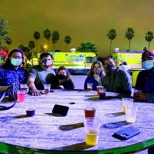 A group wearing masks enjoys an evening at the Mission Food Park during last weekend's grand opening of the new venue. Photo courtesy of Mission Food Park Facebook.