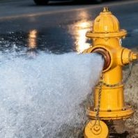 closeup-yellow-fire-hydrant-gushing-260nw-1301547373